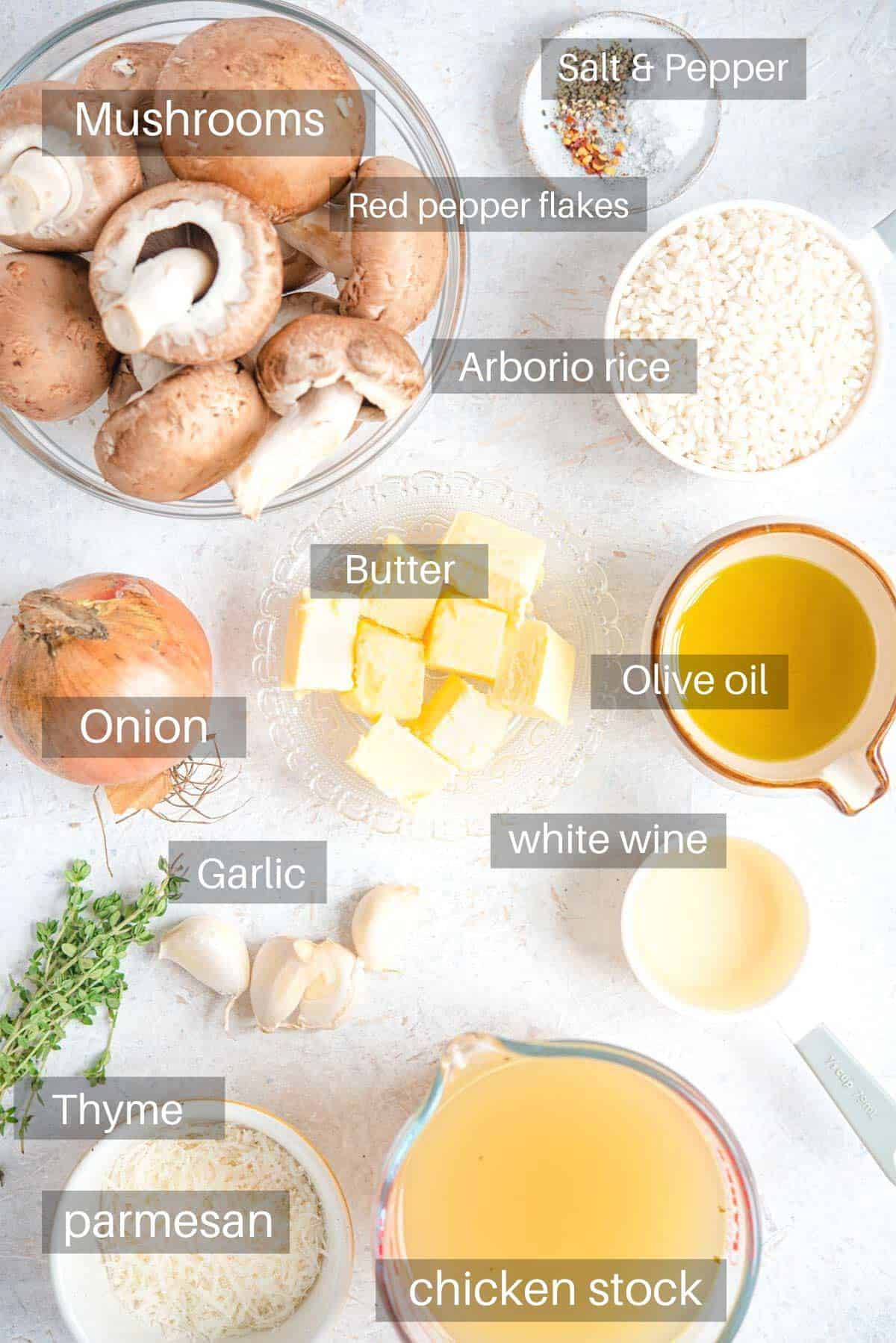 An overhead shot of all the ingredients needed to make mushroom risotto