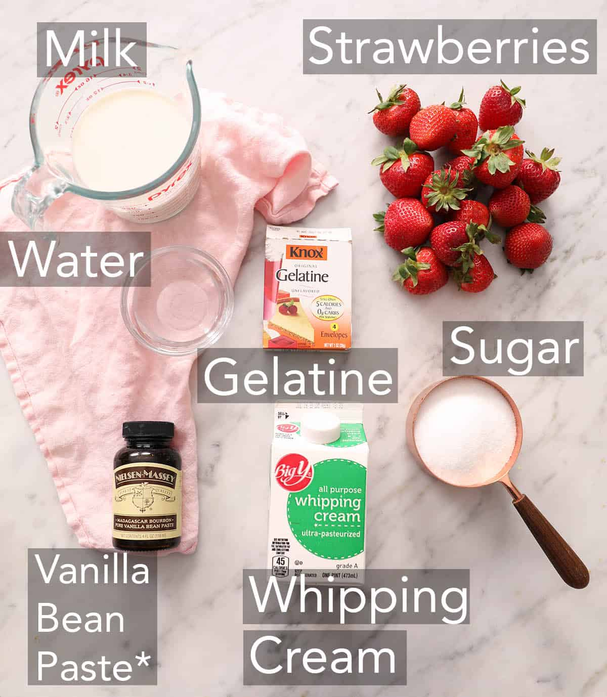 Ingredients for making panna cotta a counter.