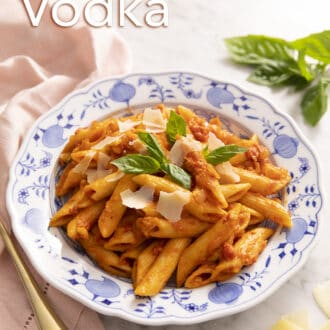 Penne alla vodka on a marble counter.
