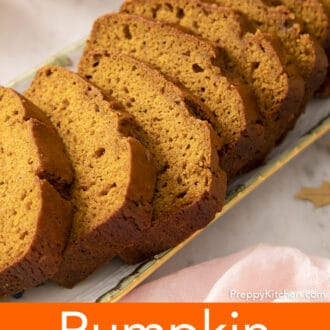 A loaf of pumpkin bread cut into slices.