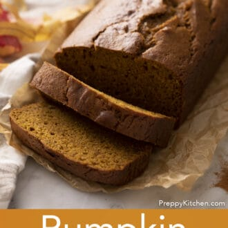 A loaf of pumpkin bread with two slices cut out.