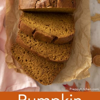 A top-down photo of pumpkin bread with three sliced pieces.