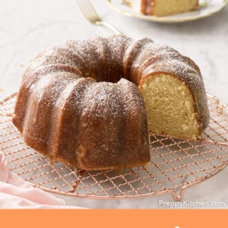 A rum cake on a copper rack.