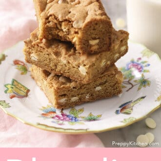 A stack of blondies with a bite taken out of the top.