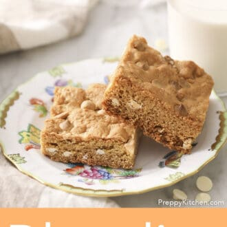 Two blondies on a porcelain plate.