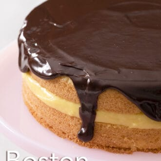 A Boston cream pie with drips of chocolate ganache.