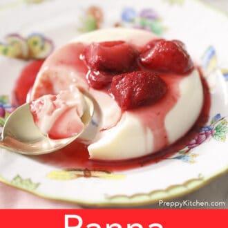 A partially eaten panna cotta with strwawberries.