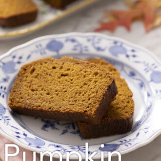 Two slices of pumpkin bread on a blue and white plate.