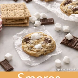 A s'mores cookie on parchment paper next to Graham crackers.