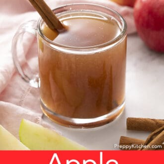 Apple cider in a glass mug.