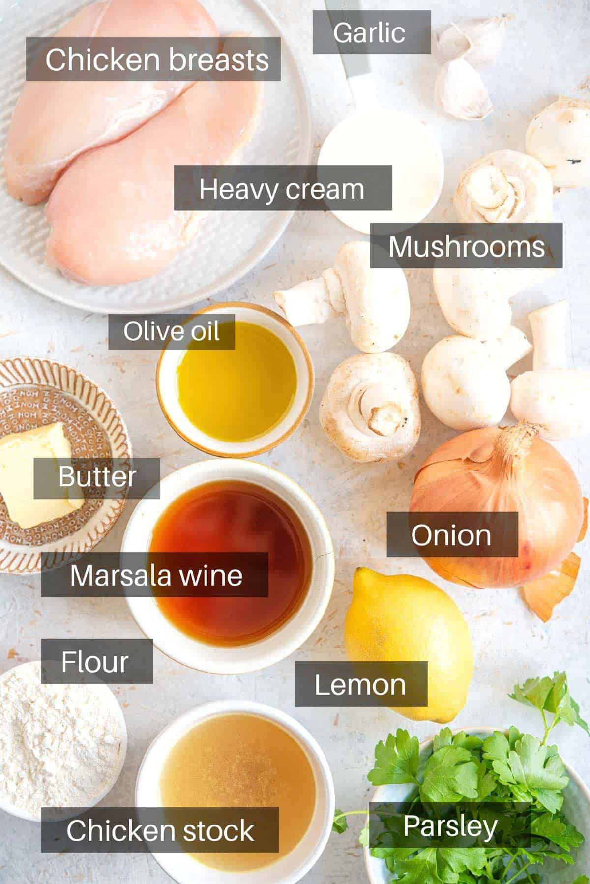 An overhead shot of all the ingredients you need to make chicken marsala