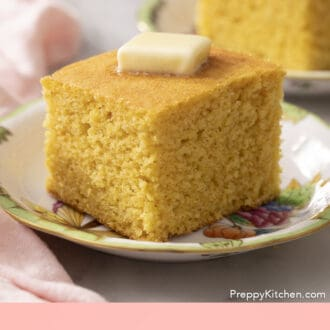 A big square piece of cornbread topped with butter.