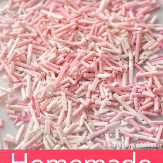 Many pink and white homemade sprinkles on a counter.
