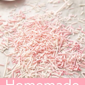 Light pink and white homemade sprinkles on a counter.