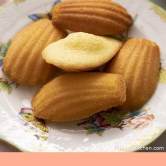 Homemade Madeleines on a porcelain plate.