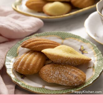 Four Madeleines on a green and white plate.