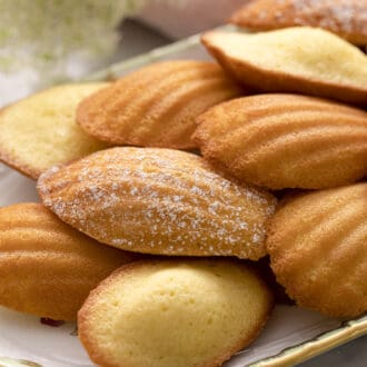 Madeleines on a porcelain serving tray.