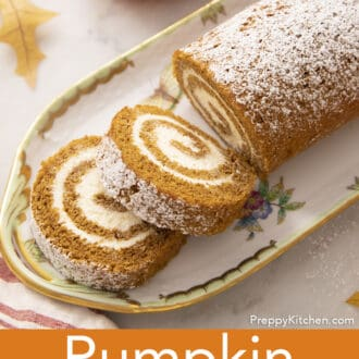 A pumpkin roll cake on a porcelain tray.