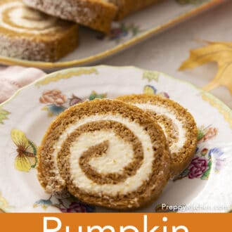 Pumpkin roll cake with cream cheese frosting on a plate.