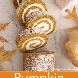 Pieces of pumpkin roll cake on a marble table.
