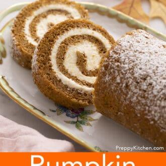 A pumpkin roll on a serving plate.
