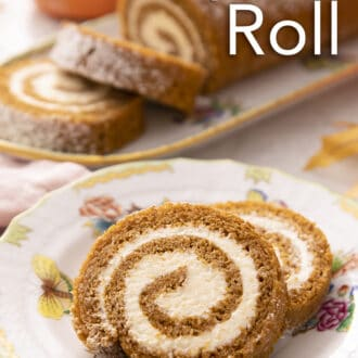 Two pieces oof pumpkin roll cake on a plate.