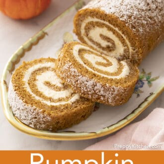 A pumpkin roll cake with two pieces cut away.