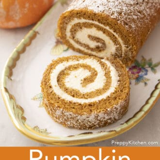A pumpkin roll with a piece cut away.