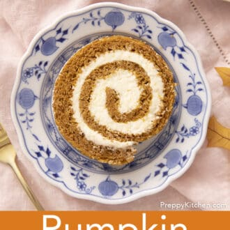 A piece of a pumpkin roll cake on a blue and white plate.