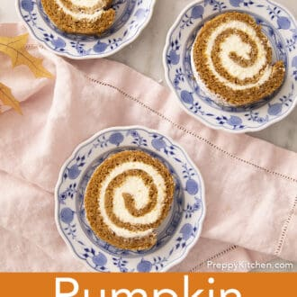 Three blue and white plates with pieces of pumpkin roll cake.