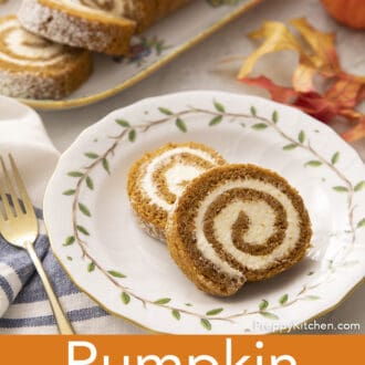 Pieces of pumpkin roll cake on a plate painted with leaves.