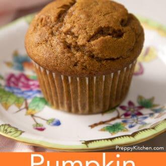 A fluffy pumpkin muffin on a porcelain plate.