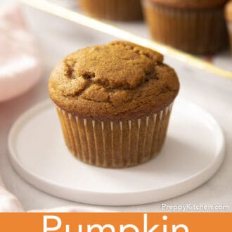 A pumpkin muffin on a white plate.