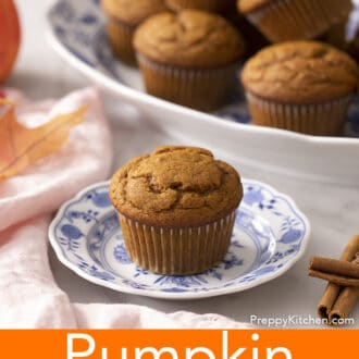 A pumpkin muffin on a blue and white plate.