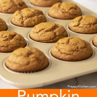 A group of pumpkin muffins in the baking tin.