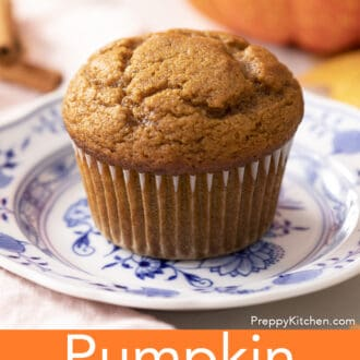 A pumpkin muffin on a small blue and white plate.