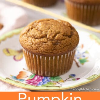 A delicious pumpkin muffin on a plate.