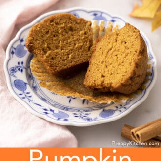 A pumpkin muffin cut in half on a plate next to some cinnamon..
