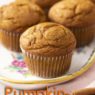 A group of pumpkin muffins on a tray.