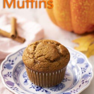 A pumpkin muffin next to a pumpkin.