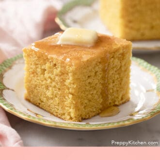 A piece of cornbread dripping with honey.