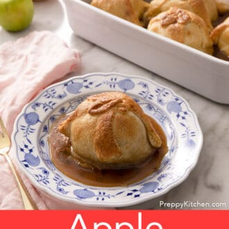 A group of apple dumplings on a marble counter.
