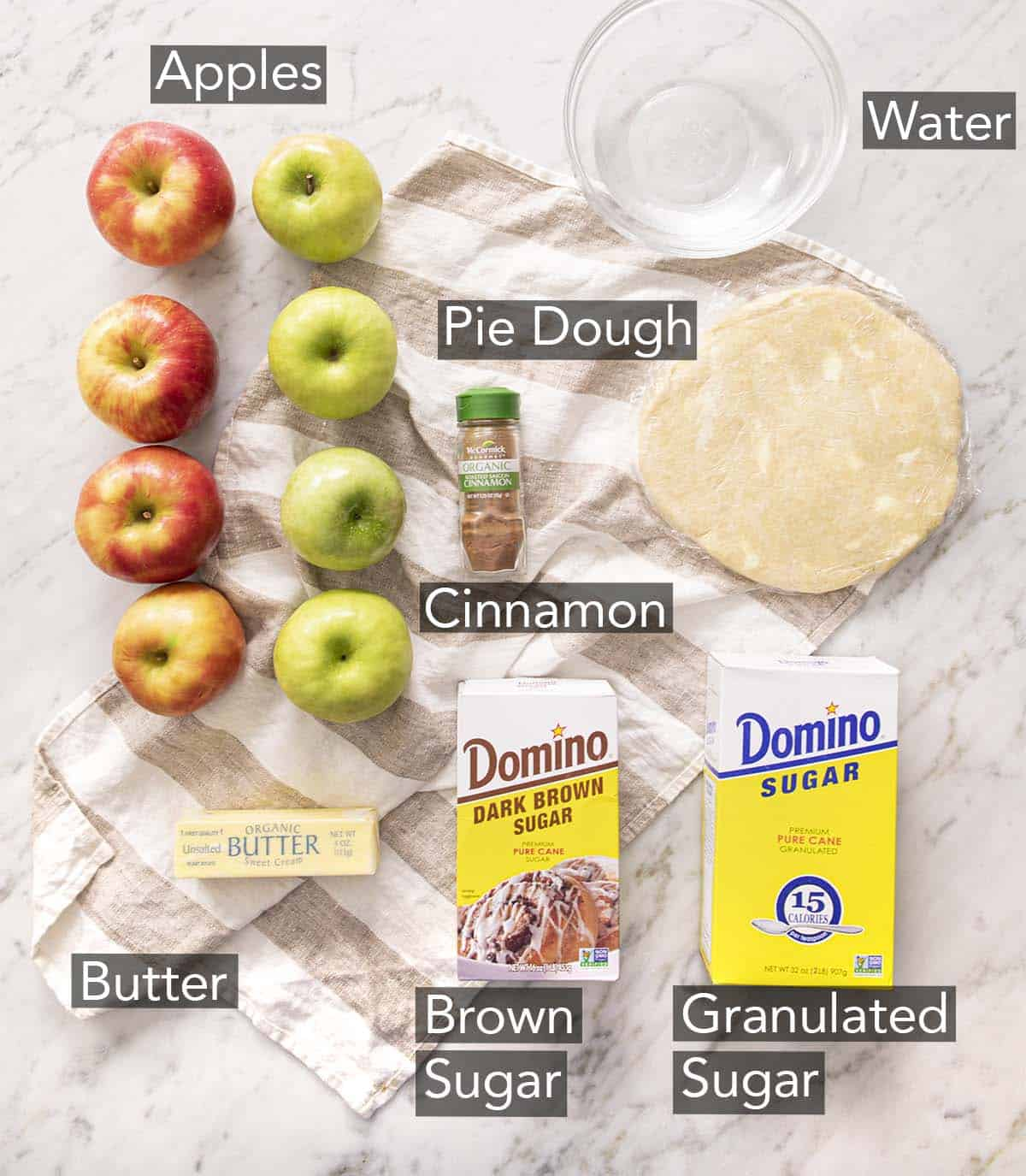 Ingredients for making apple dumplings on a counter.