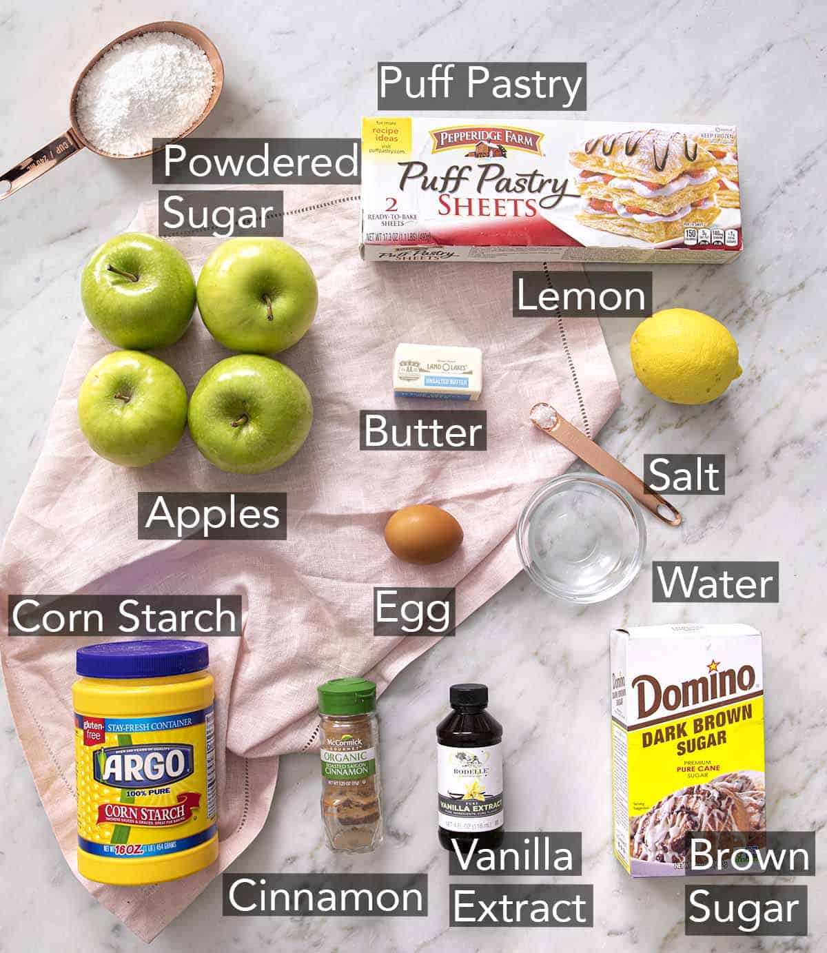 Ingredients for making apple turnovers on a counter.