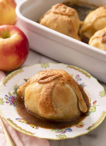 An apple dumpling on a porcelain plate.