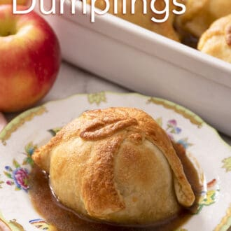 An apple dumpling next to an apple.