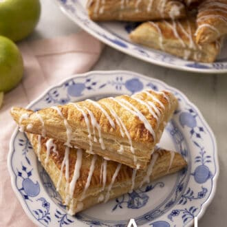 Apple turnovers on a blue and white plate.