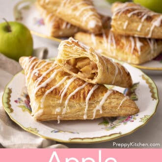 A group of apple turnovers next to a green apple.