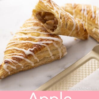 Apple turnovers next to a baking sheet.