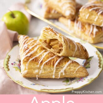 Apple turnovers with glaze on a marble counter.